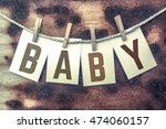 "the word ""baby"" stamped on... 