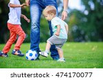 father and sons playing... | Shutterstock . vector #474170077