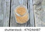 mustard seed in jar on wooden... | Shutterstock . vector #474246487