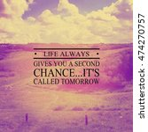 Small photo of Blurred image background of hills and sky with inspirational quote. Life always gives you a second chance...it's called tomorrow. Lighting, blurred and Instagram effects.