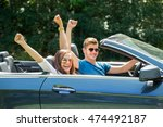 happy couple sitting in a car... | Shutterstock . vector #474492187