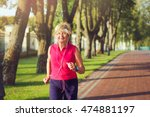 elderly woman running with... | Shutterstock . vector #474881197