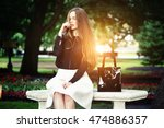 woman seating on the bench... | Shutterstock . vector #474886357