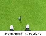 golfer putting golf ball on the ... | Shutterstock . vector #475015843