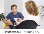 mature psychologist doing notes ...   Shutterstock . vector #475046773