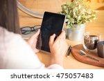 asian woman holding ipad. happy ... | Shutterstock . vector #475057483