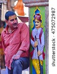 Small photo of MATHURA, INDIA - March 23, 2016 : Unidentified Indian man and traditional stucco on Hindu temple wall. Mathura is a city of north Indian state of uttar pradesh