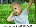 small boy talks on the phone in ... | Shutterstock . vector #475136437