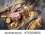 Small photo of Barbecue Lamb Knuckles on old Cutting Board