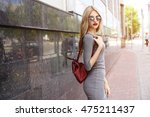 fashion portrait of young... | Shutterstock . vector #475211437
