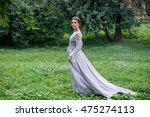 girl in elegant dress walking... | Shutterstock . vector #475274113