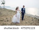happy just married young couple ... | Shutterstock . vector #475291123