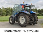 Modern Blue Tractor On A...