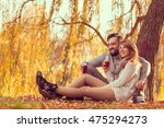 Young Couple In Love Sitting O...