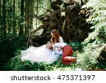 bride strokes groom's head... | Shutterstock . vector #475371397