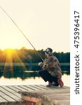 man fishes in the lakes of the... | Shutterstock . vector #475396417