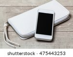 smartphone and leather woman... | Shutterstock . vector #475443253