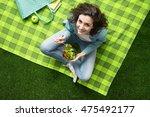smiling woman having a relaxing ... | Shutterstock . vector #475492177
