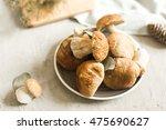 plate with fresh white mushrooms | Shutterstock . vector #475690627