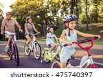 happy family is riding bikes... | Shutterstock . vector #475740397