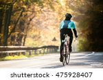 young sportsman riding bicycle... | Shutterstock . vector #475928407