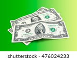 dollars on a green background | Shutterstock . vector #476024233