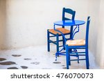 Two Blue Chairs On A Streetof...