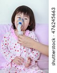Small photo of Closeup asian child having respiratory illness helped by doctor with inhaler. Nurse take care girl with asthma problems making inhalation with mask at hospital. child was bronchitis and crying.