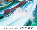 Children On Water Slide In Aqu...
