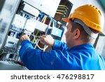electrician installing energy... | Shutterstock . vector #476298817