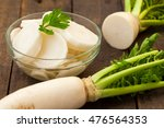 White Daikon Radish On Rustic...