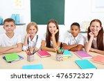 schoolchildren sitting at table ... | Shutterstock . vector #476572327