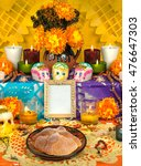 Small photo of Day of the dead altar with sugar skulls and candles, yellow background