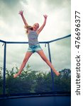 girl jumping on a trampoline | Shutterstock . vector #476696377