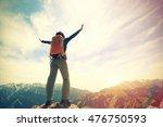 cheering young woman hiker open ... | Shutterstock . vector #476750593