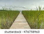 wooden walkway leading to  lake | Shutterstock . vector #476758963