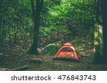 camping site with two tents in... | Shutterstock . vector #476843743