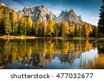 Stock photo autumn colorful dolomites mountain peaks in italy with blue sky reflecting in the lake 477032677