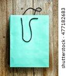 paper shopping bag on wooden...   Shutterstock . vector #477182683