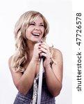 pretty girl singing into... | Shutterstock . vector #47726578