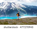 hiking man in the mountains | Shutterstock . vector #477270943