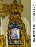 Small photo of wooden commemoration altarpiece dedicated to Our Lady of Consolation with sentence in Italian language meaning Hail Mary in a shrine opened only on the day of Assumption of Mary, the 15th of August