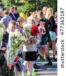 students with bouquets. st.... | Shutterstock . vector #477363187