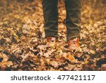 feet sneakers walking on fall... | Shutterstock . vector #477421117