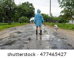 a boy in a raincoat with a dog... | Shutterstock . vector #477465427
