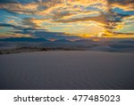 Small photo of White sand dunes national park in New Mexico at sunset dramatic colorful land of enchantment