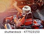 men driving go kart car with... | Shutterstock . vector #477523153