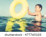 funny excited child playing... | Shutterstock . vector #477765103
