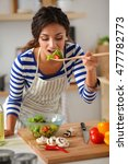 young woman eating fresh salad... | Shutterstock . vector #477782773