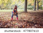 Boy Playing With Autumn Leaves...